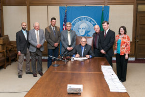 Gov. Jay Inslee signs Substitute House Bill No. 1586, May 18, 2015. Relating to the Royal Slope railroad.