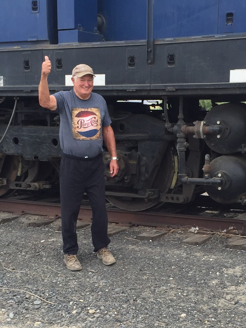 Former Port Commissioner Frank Mianecki gives a thumbs up for the first locomotive to arrive in Royal in over 25 years.  Frank worked many, many hours removing rock slides and debris to open up the line from Othello to Royal to rail traffic.  He is greatly missed.